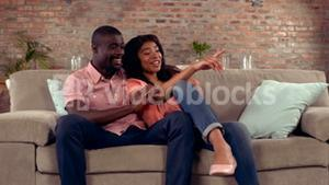 Happy couple sitting on the couch