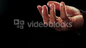 Hand catching a dice