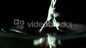 Coins dropping in water