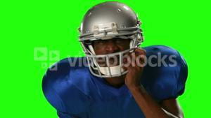 American football player on green screen