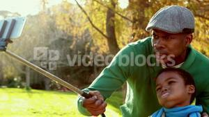 Happy father and son in the country on autumns day