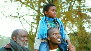 Father son and grandfather in the park