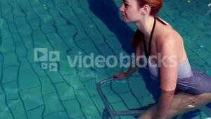 Fit woman cycling in the pool