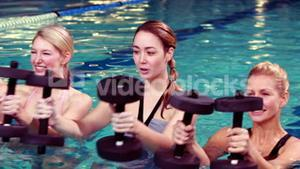 Fitness group doing aqua aerobics
