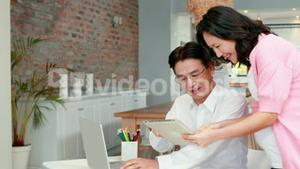 Pregnant asian couple planning together