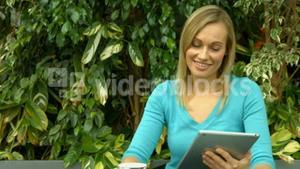 Student using tablet outside on campus