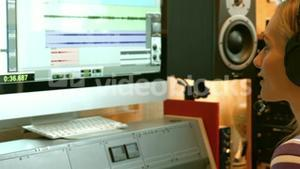 Student mixing music in the studio