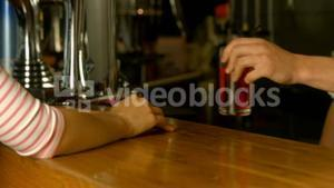 Woman being served drink at the bar