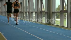 Couple jogging on indoor track