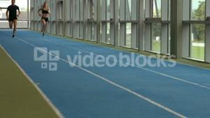 Couple racing on indoor track