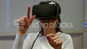 Woman using oculus rift in college