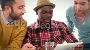 Casual business team watching on a tablet