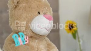 Close up of a teddy bear on bed