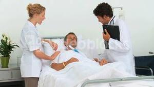 Two doctors visiting a patient