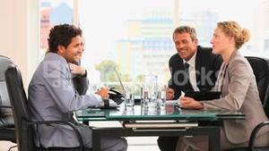 Four business people talking