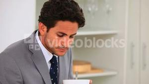 Businessman eating his breakfast quickly