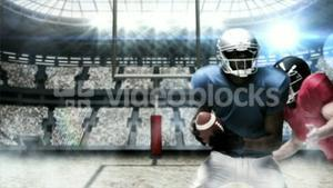 Tackled american football player launching ball