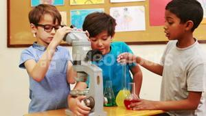 Pupils doing science together in class