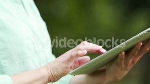 Teacher using her tablet outside