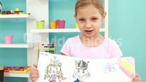 Little girl showing her picture
