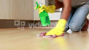 Woman cleaning her kitchen floor