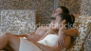 Couple relaxing in thermal suite
