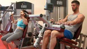 Fit couple using weight machines