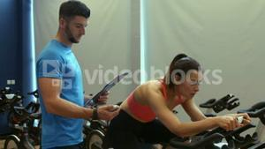 Fit couple spinning in gym
