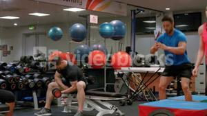 Fit people working out in gym