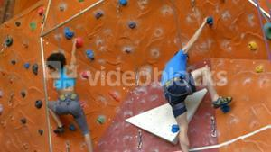 Rock climbers ascending the wall