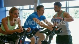 Spin class working out in the gym