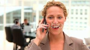 Blonde business woman talking on the phone
