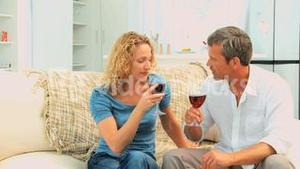 Lovely couple enjoying a french wine