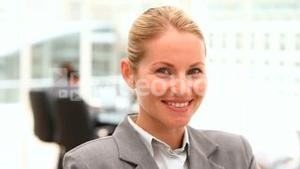 Blonde business woman looking at the camera
