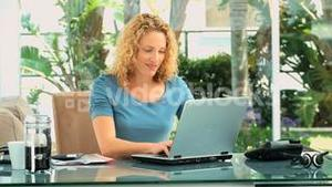 Casual blonde woman working