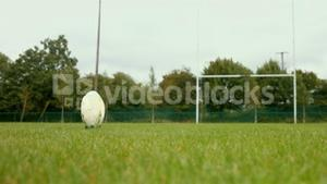 Close up of a rugby player kicking a rugby ball