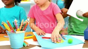 Kids playing together with arts and crafts items