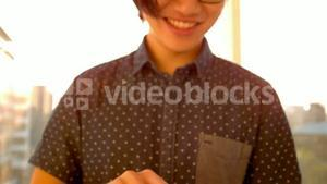 Happy hipster using his tablet pc
