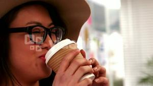 Gorgeous hipster drinking out of take-away cup
