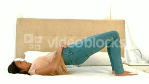 Woman trying to zip up jeans
