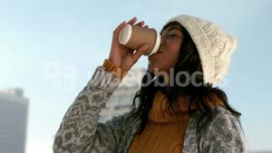 Woman enjoying hot drink on winters day