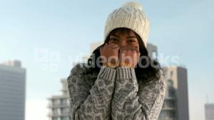 Woman shivering on a winters day