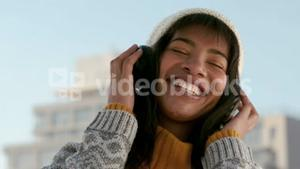 Woman listening to music on a winters day