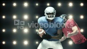 American football players against flashing lights