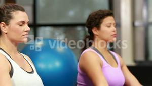 Pregnant women in fitness studio