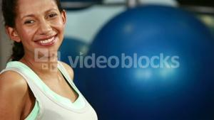 Pregnant woman in fitness studio