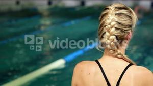 Fit blonde in the swimming pool