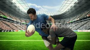 Serious rugby players tackling for ball