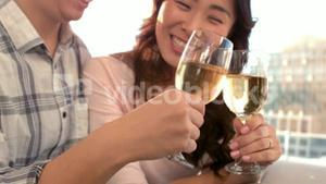 Asian happy couple drinking wine