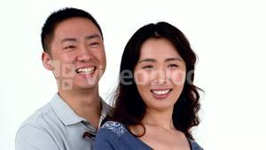 Portrait of Asian smiling couple hugging